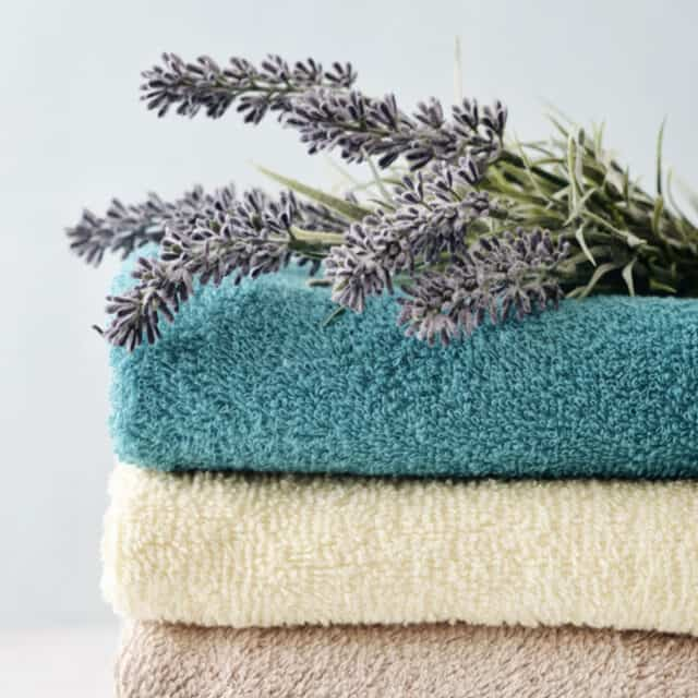 Stack of bath towels with lavender flowers