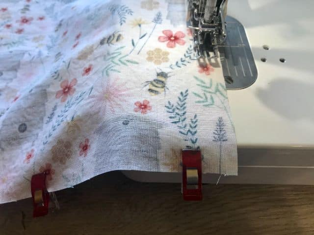 Sewing machine stitching around placemat