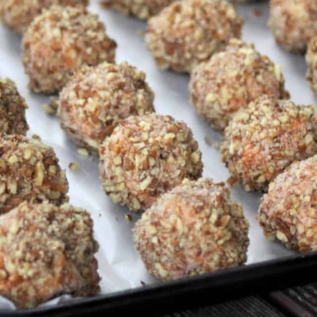 Nut crusted sweet potato balls on a cookie sheet.