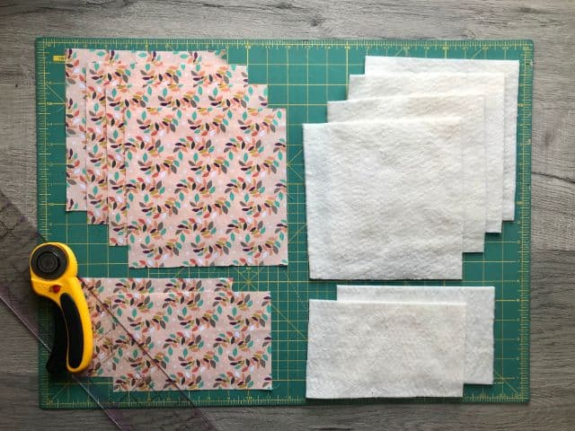 "Fabric and batting cut into 8"" squares"
