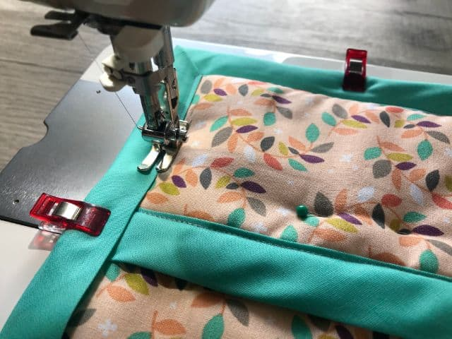 Top stitching bias tape around hot pad on sewing machine