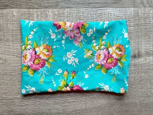 "Right side out rectangle of teal floral fabric sewn with 3"" opening at one end"