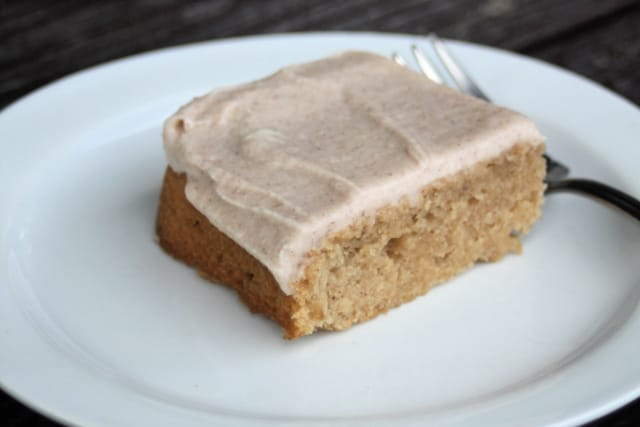 A frosted apple butter bar on a white plate with a fork.