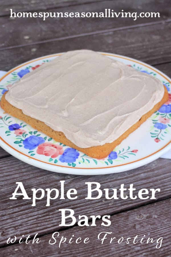 A pan of uncut Frosted Apple Butter Bars on a floral cake plate with text overlay.