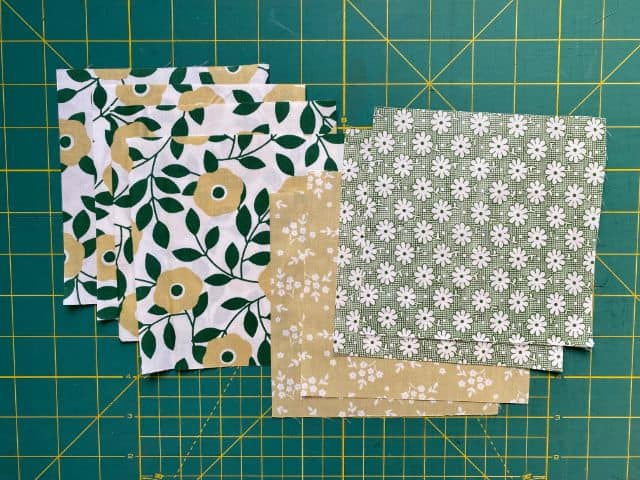Fabric squares cut to size on cutting mat