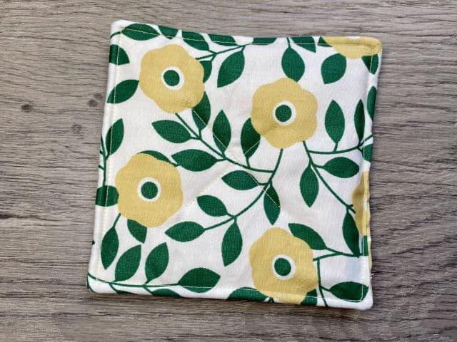 Fabric mug rug with green and tan flowers