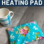 A floral heating pad sitting on a table next to a coffee cup with text overly stating: how to sew rice filled heating pad.
