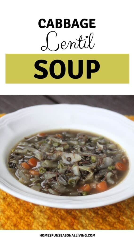 A white bowl full of cabbage lentil soup sitting on an orange table runner with text overlay reading cabbage lentil soup.