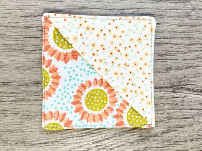 Completed fabric corner bookmark with top stitching all the way around