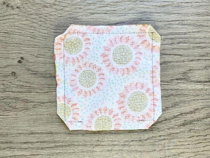 Square of fabric with corners snipped off
