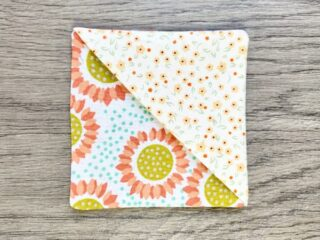 Square flower fabric with triangle fabric overlay at one side