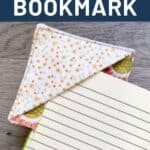 A fabric bookmark on the corner of black journal page with text overlay reading how to make a fabric bookmark.