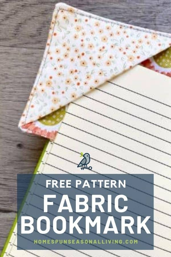 A fabric bookmark on the corner of a journal page with text overlay reading: free pattern fabric bookmark.